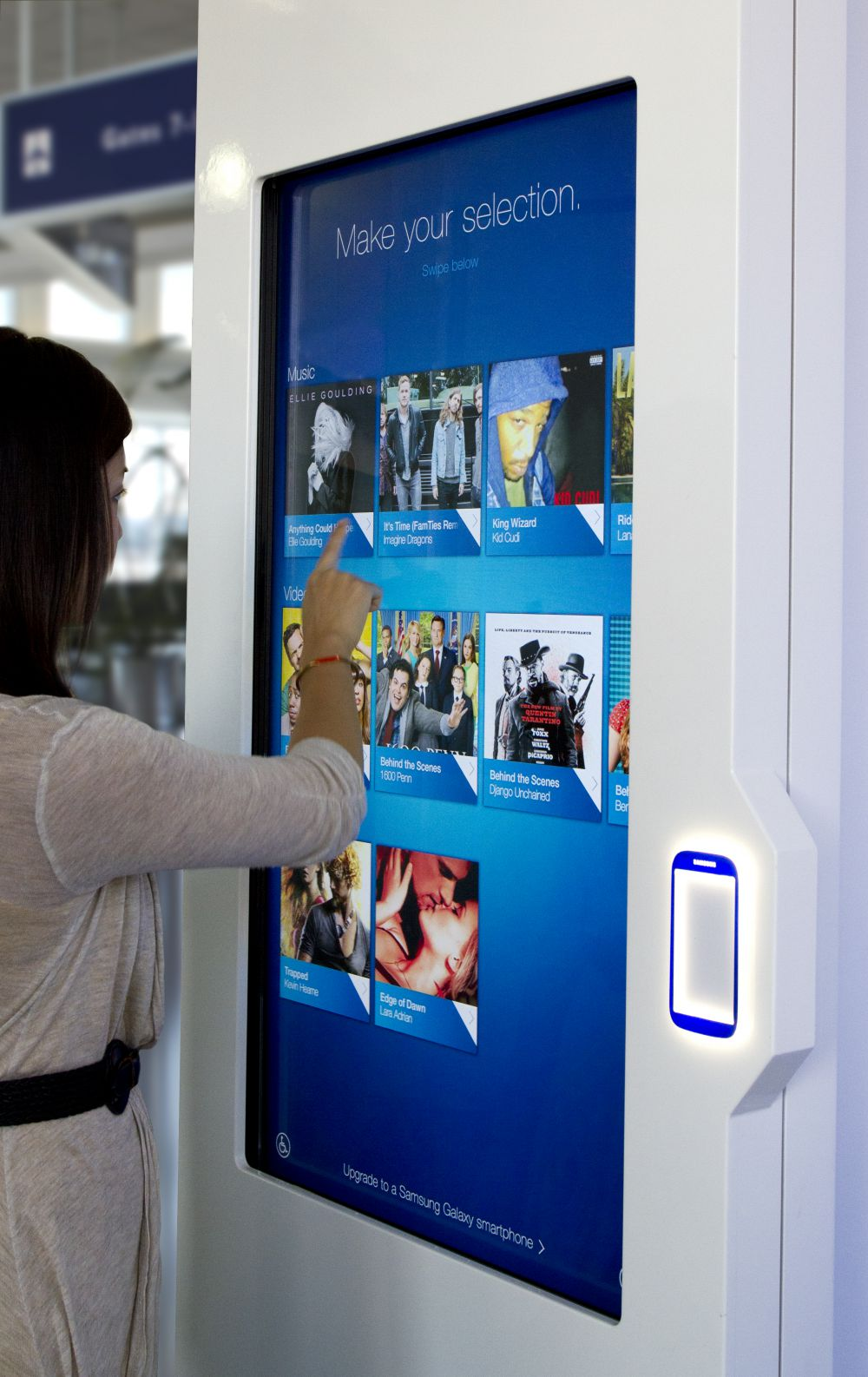 User interacting with the Samsung NFC kiosk screen