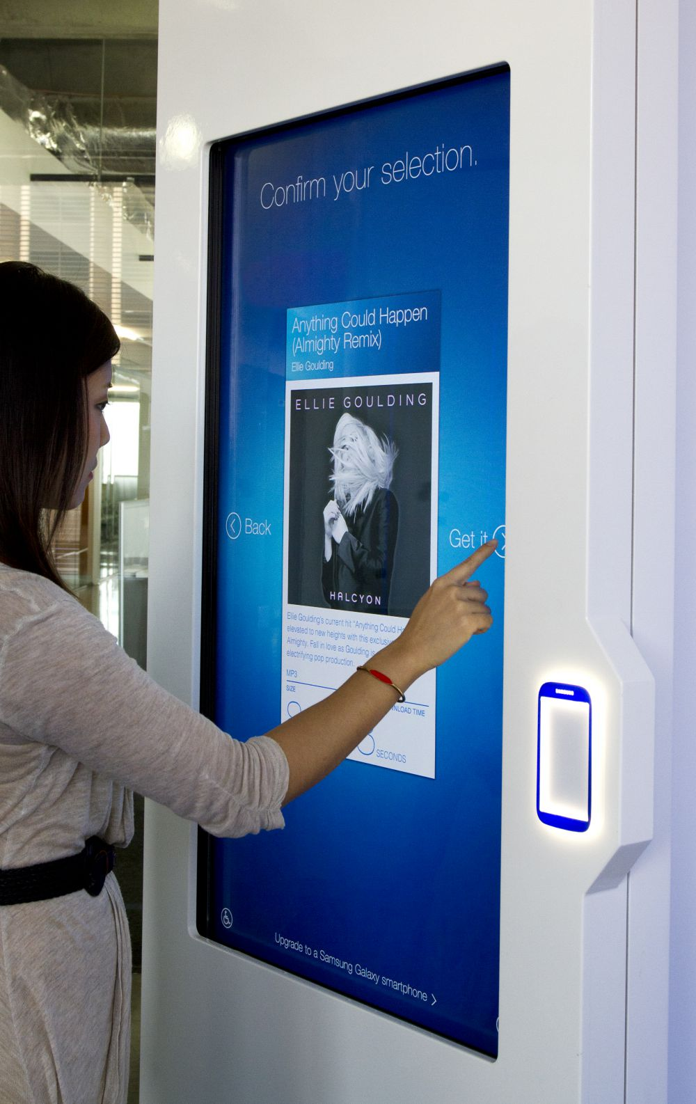 User selecting content to download via the Samsung NFC kiosk screen