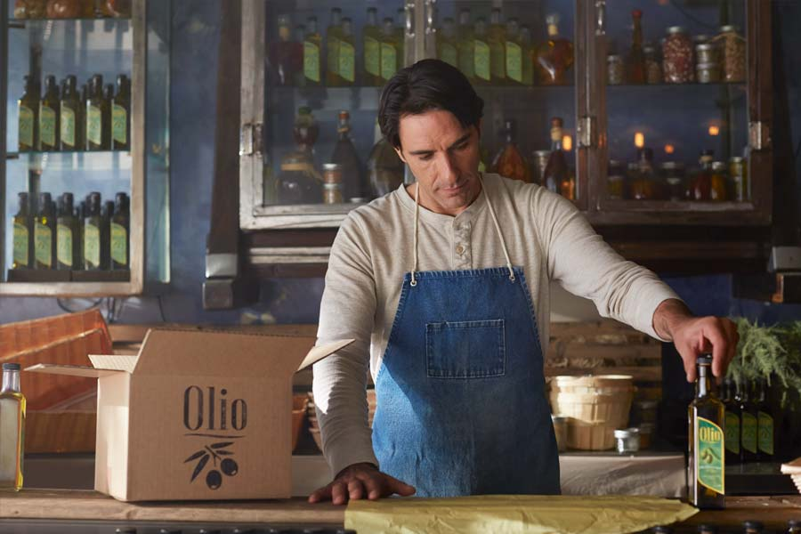 olive oil maker preparing to pack product for shipping