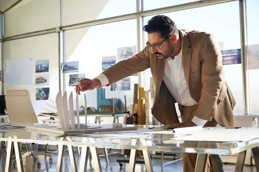 architect inspecting architectural model
