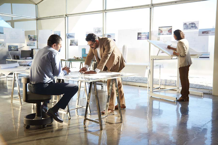 people working in office space of architectural firm