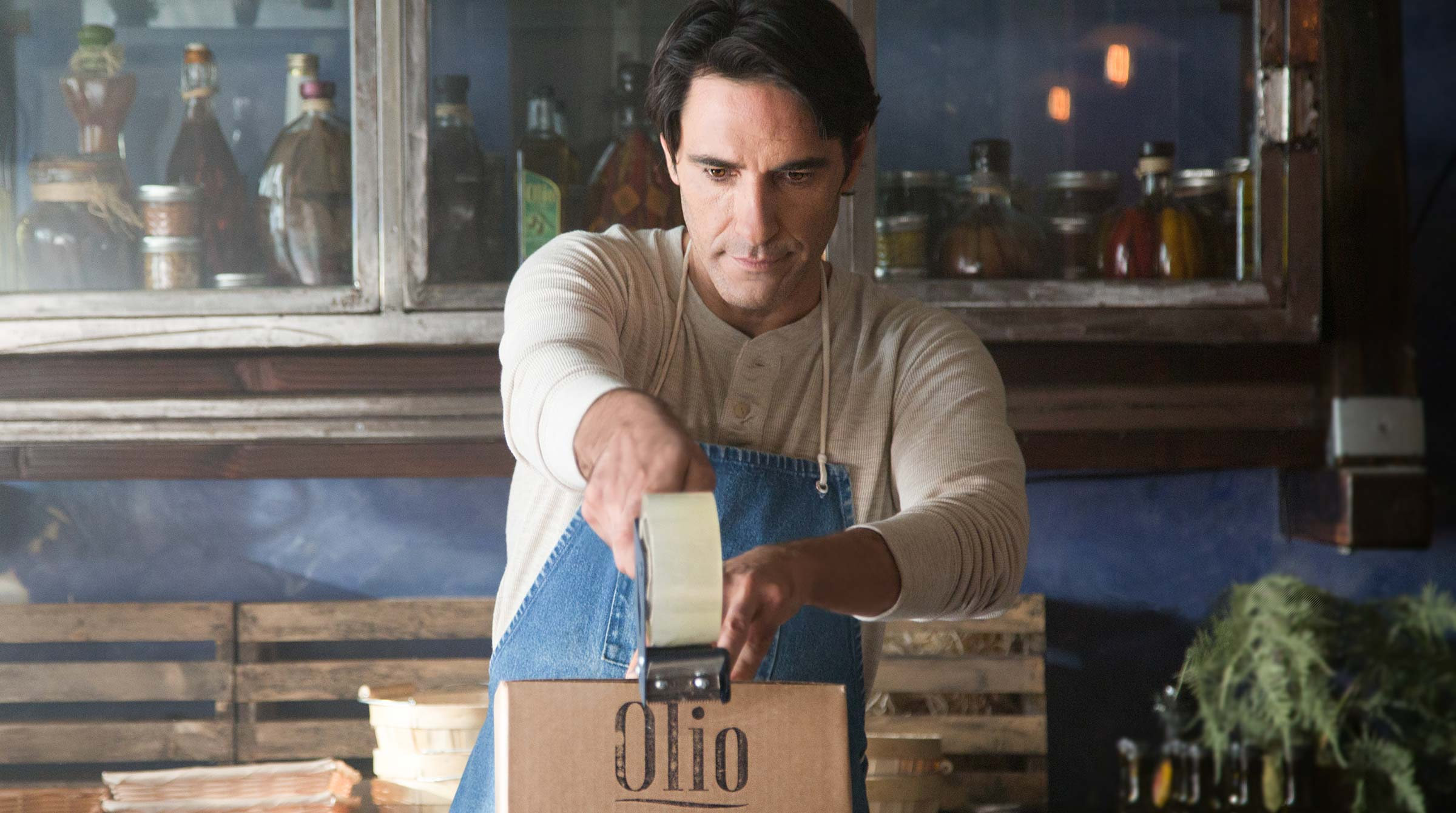 UPS brand imagery - olive oil maker packing a shipping box