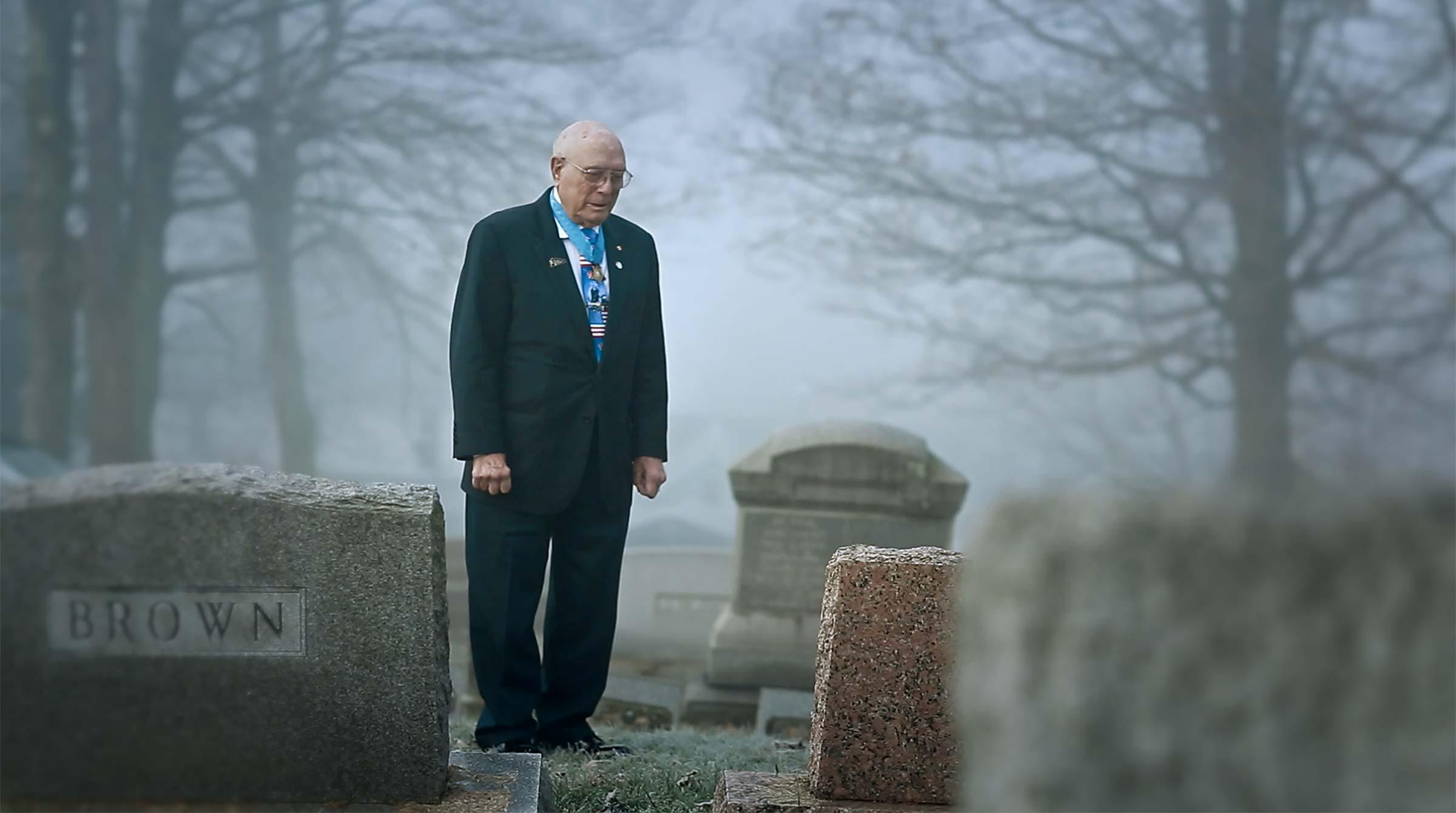 "Hershel Woodrow ""Woody"" Williams at the grave of friend Leonard Brown"